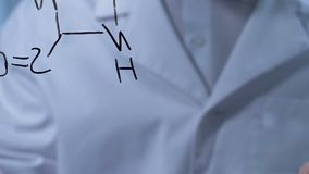 Scientist working on creation of new formula, conducting and recording research. Stock footage stock footage