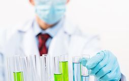 Scientist working in the lab. Examines a test tube with liquid Royalty Free Stock Images
