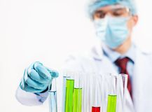 Scientist working in the lab. Examines a test tube with liquid Stock Image