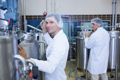 Scientist working and smiling at camera. In the factory Stock Photo