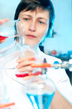 Scientist works in a chemical lab Stock Photos