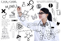 Scientist writes formula Stock Photo