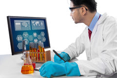 Scientist writes the research result Stock Photos