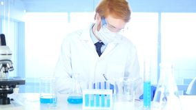 Scientist Writing Details, Result of Research in Laboratory stock image