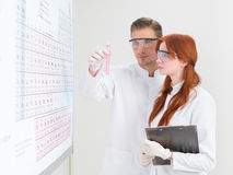 Scientists analysing a test-tube Stock Photography