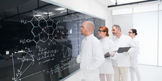 Scientists analyzing formulas in lab Stock Photography