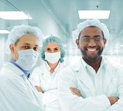 Scientists arabic team at hospital lab, group of doctors Stock Photos