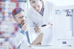 Scientists conferring in laboratory Royalty Free Stock Image