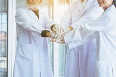 Scientists coordinate hand,Group of people teamwork in laboratory,Successful and reserch working. Scientists coordinate hands,Group of people teamwork in royalty free stock images