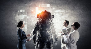 Scientists designing space suit. Mixed media . Mixed media Royalty Free Stock Images