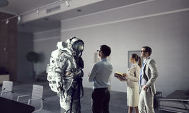 Scientists designing space suit. Mixed media . Mixed media Royalty Free Stock Photo