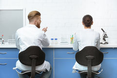 Scientists discussing analysis during work in lab Royalty Free Stock Images