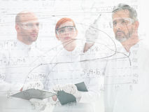 Scientists discussing a diagram Royalty Free Stock Photography
