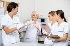 Scientists Discussing Over Sample In Laboratory. Team of scientists discussing over sample in medical laboratory Royalty Free Stock Images