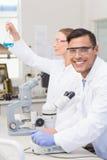 Scientists examining blue precipitate Stock Image