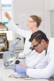 Scientists examining blue precipitate Stock Images
