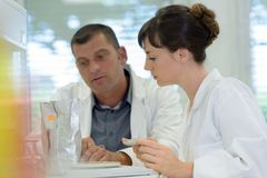 Scientists examining in lab with test tubes royalty free stock image
