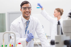 Scientists examining tubes and baker Royalty Free Stock Image