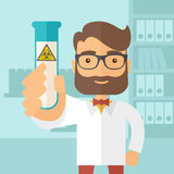 Scientists experimenting with glass tube Stock Photography