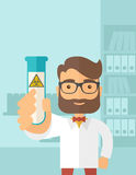 Scientists experimenting with glass tube Royalty Free Stock Image