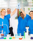Scientists high five. Successful team of scientists high five in lab royalty free stock photo