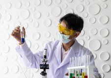 Scientists holding a beaker. stock photography