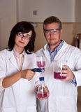 Scientists holding labware. After performing experiments Stock Images