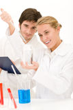 Scientists in laboratory with chemicals Stock Photos