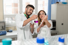 Scientists In Laboratory With Chemicals Testing Virus Vaccinatio Stock Photo