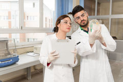 Scientists In Laboratory With Chemicals Testing Virus Vaccinatio Stock Photography