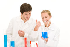 Scientists in laboratory - flu virus test tube. With red liquid stock photo