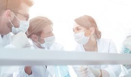 Medical researcher microbiology experiment in the laboratory. Scientists in the laboratory wearing protective goggles, looking at the flask Stock Photography
