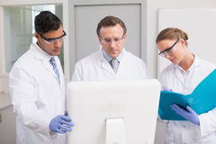 Scientists looking attentively at computer. In laboratory Stock Photos