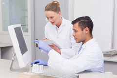 Scientists looking at computer. In the laboratory Stock Images