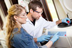 Scientists research in a lab environment Royalty Free Stock Photo