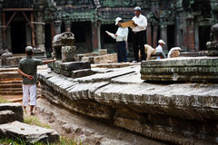 Scientists restore ruins Angkor Wat UNESCO site. SIEM REAP, CAMBODIA - DEC. 26: Scientists and workers conducting  preservation and restoration efforts at UNESCO Stock Photos