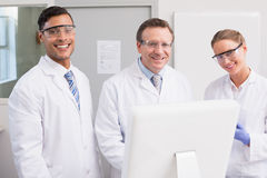 Scientists smiling and looking at camera. In laboratory Royalty Free Stock Photo