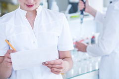 Scientists in sterile coats Royalty Free Stock Image