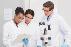 Scientists taking notes Royalty Free Stock Photos