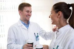 Scientists talking and holding coffee Stock Image