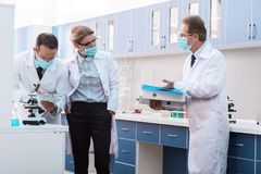Scientists talking in laboratory royalty free stock image