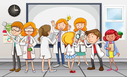 Scientists and teacher in the classroom Royalty Free Stock Photo