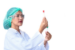 Scientists in uniform are analyzing glass tubes Royalty Free Stock Image