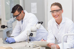 Scientists using microscope Royalty Free Stock Photography