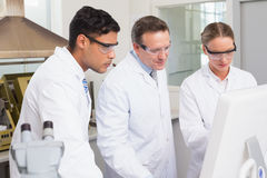 Scientists working attentively with computer. In laboratory Royalty Free Stock Photo