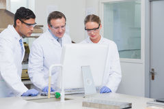 Scientists working on computer together. On the laboratory Royalty Free Stock Photography