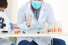 Scientists working in laboratory stock images