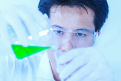Scientists working at the laboratory,scientist leaning against t. He whiteboard in laboratory,scientist background,male scientist looking in laboratory Stock Photo