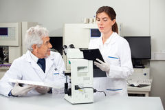 Scientists Working In Medical Laboratory Royalty Free Stock Photography