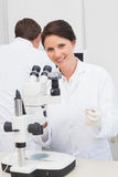 Scientists working with microscope and computer. In laboratory Stock Image